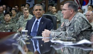 U.S. President Barack Obama is briefed by U.S.-ROK Combined Forces Command officers including U.S. Army Gen. Curtis Scaparrotti, right, Commander UNC/CFC/USFK, at the U.S. Army Garrison Yongsan, South Korea , Saturday, April 26, 2014. South Korean President Park Geun-hye was also at the briefing. (AP Photo/Carolyn Kaster)