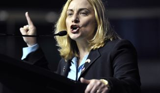 **FILE** Salem immigration lawyer and senatorial hopeful Marisa DeFranco addresses delegates during the Democratic Convention at the Tsongas Arena in Lowell, Mass., on June 4, 2011. The state convention included addresses by the six hopefuls seeking the U.S. Senate seat currently held by Scott Brown. (Associated Press)