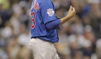 Chicago Cubs pitcher Carlos Villanueva reacts after giving up an RBI single to Milwaukee Brewers' Jonathan Lucroy during the third inning of a baseball game Friday, April 25, 2014, in Milwaukee. (AP Photo/Darren Hauck)