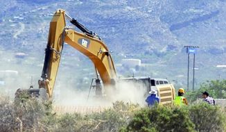 "Crews begin digging at the old Alamogordo, N.M., landfill on Friday April 25, 2014, to search for copies of the Atari game ""E.T. The Extraterrestrial"" purportedly buried there in the 1980s.  The game is considered among gamers to be one of the worst ever and is believed to have contributed to the demise of Atari. (AP Photo/Alamogordo Daily News, John Bear)"