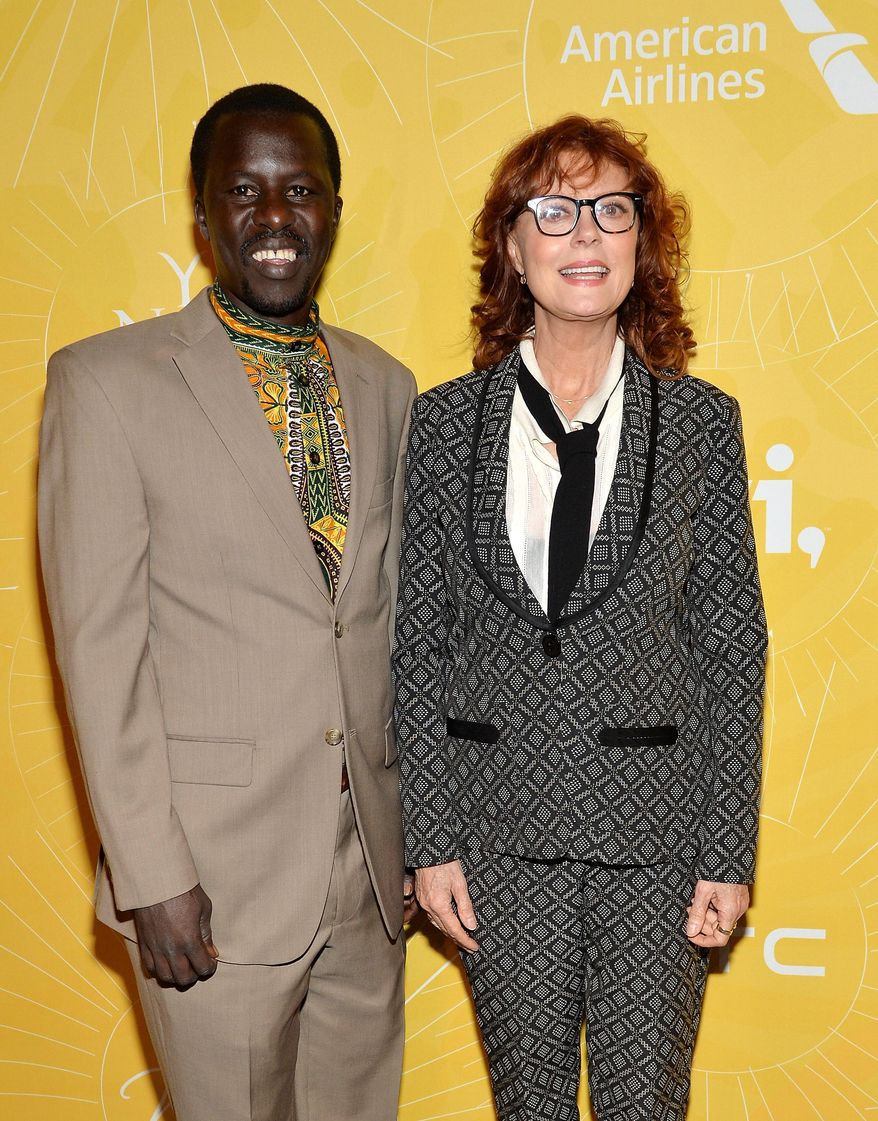 """Actress Susan Sarandon, right, and Hope North founder Okello Sam attend Variety's """"Power of Women: New York"""" luncheon at Cipriani Midtown on Friday, April 25, 2014 in New York. (Photo by Evan Agostini/Invision/AP)"""
