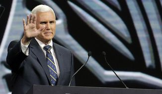 ** FILE ** Gov. Mike Pence waves after speaking at the leadership forum at the National Rifle Association's annual convention in Friday, April 25, 2014, in Indianapolis. (AP Photo/AJ Mast)