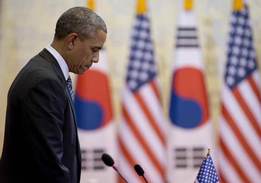 U.S. President Barack Obama pauses for a moment of silence for those who died in the ferry disaster as Obama and South Korean President Park Geun-hye, participate in the bilateral meetings at the Blue House, Friday, April 25, 2014, in Seoul, South Korea. (AP Photo/Carolyn Kaster)