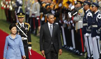 U.S. President Barack Obama, right, and South Korean President Park Geun-hye, left, inspect an honor guard during a welcoming ceremony at the presidential Blue House in Seoul Friday, April 25, 2014. (AP Photo/Kim Hong-Ji, Pool)