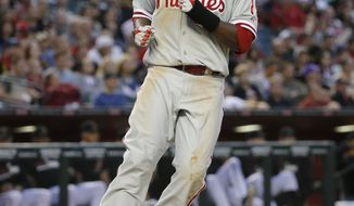 Philadelphia Phillies' Tony Gywnn Jr. scores on a ground out by Jimmy Rollins during the seventh inning of a baseball game against the Arizona Diamondbacks on Saturday, April 26, 2014, in Phoenix. (AP Photo/Matt York)