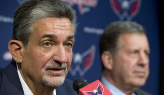 Washington Capitals owner Ted Leonsis, left, and president Dick Patrick announce that the Capitals have fired coach Adam Oates and will not renew the contract of general manager George McPhee after failing to make the NHL playoffs for the first time since 2007, during a news conference in Washington Saturday April 26, 2014. The team announced the moves in a news release Saturday, followed by a news conference. (AP Photo/Jacquelyn Martin)