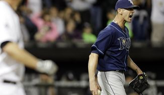 Tampa Bay Rays closer Grant Balfour, right, reacts as Chicago White Sox's Paul Konerko walks to first base during the ninth inning of a baseball game in Chicago on Friday, April 25, 2014. The White Sox won 9-6. (AP Photo/Nam Y. Huh)