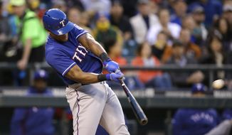 Texas Rangers' Adrian Beltre doubles in a run against the Seattle Mariners in the fourth inning of a baseball game on Friday, April 25, 2014, in Seattle. (AP Photo/Elaine Thompson)