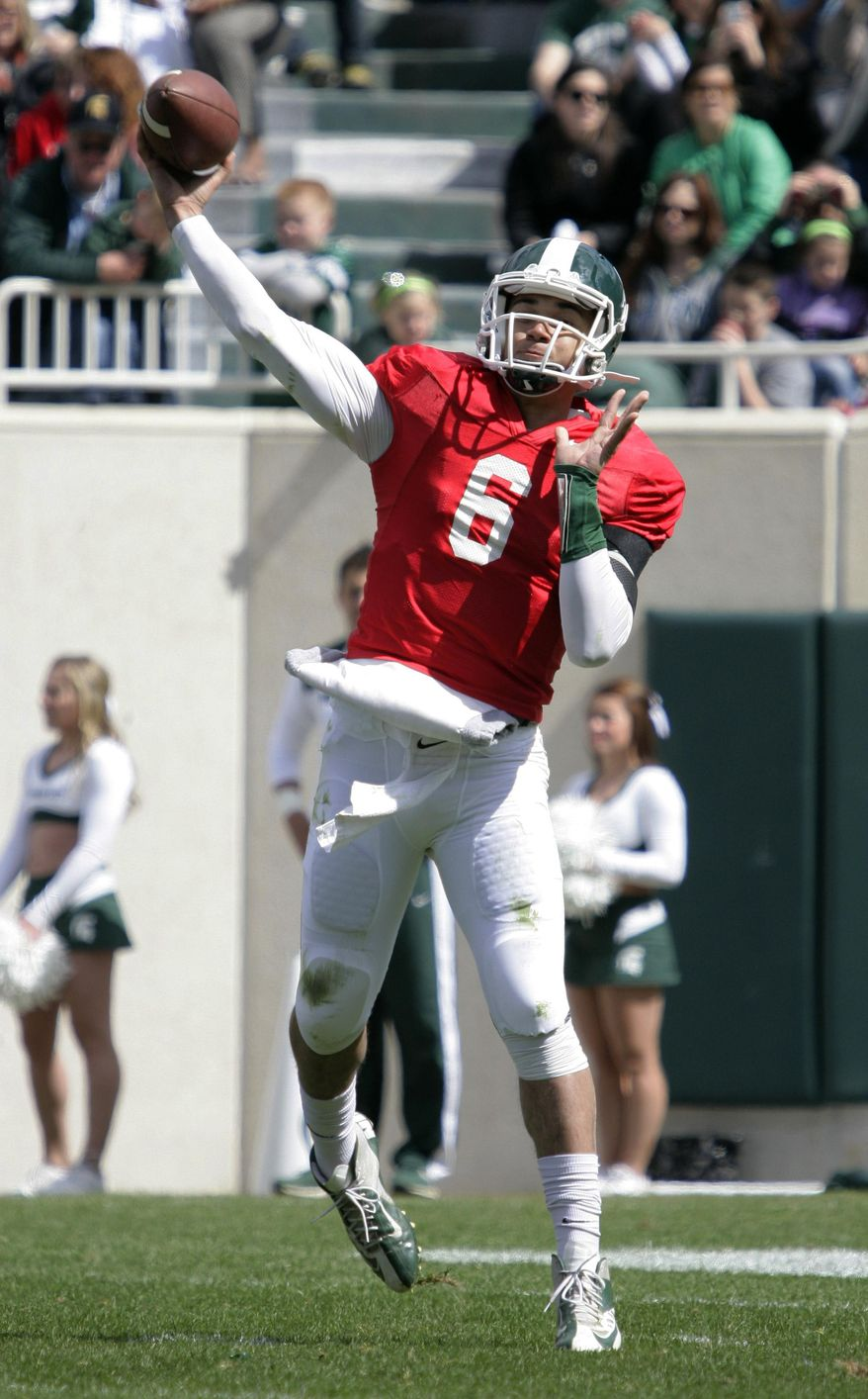 Michigan State quarterback Damion Terry throws a pass during the NCAA college football team's scrimmage, Saturday, April 26, 2014, in East Lansing, Mich. (AP Photo/Al Goldis)
