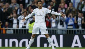 Real's Cristiano Ronaldo celebrates his goal during a Spanish La Liga soccer match between Real Madrid and Osasuna at the Santiago Bernabeu stadium in Madrid, Spain, Saturday, April 26, 2014. (AP Photo/Andres Kudacki)