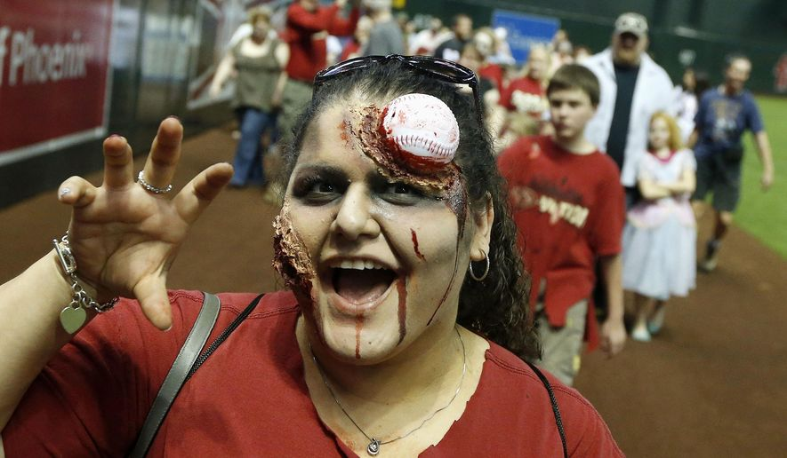 Arizona Diamondbacks fan Roberta Alvarez, of Casa Grande, Ariz., participates a zombie walk on Zombie Night at Chase Field prior to a baseball game between the Philadelphia Phillies and the Diamondbacks on Friday, April 25, 2014, in Phoenix. (AP Photo/Ross D. Franklin) ** FILE **