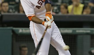 Houston Astros' Dexter Fowler hits an RBI-single against the Oakland Athletics in the eighth inning of a baseball game on Saturday, April 26, 2014, in Houston. (AP Photo/Pat Sullivan)