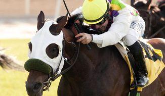 In this photo provided by Benoit Photo, Richard Kritzski's Awesome Return and jockey Joe Talamo win the $250,000 Snow Chief Stakes horse race, Saturday April 26, 2014, at Santa Anita Park in Arcadia, Calif. (AP Photo/Benoit Photo)