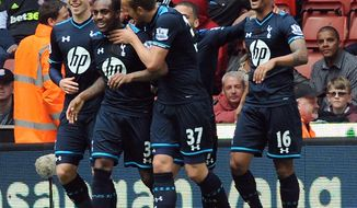 Tottenham's Danny Rose, second left, is congratulated by teammates after scoring against Stoke during the English Premier League soccer match between Stoke City and Tottenham Hotspur at the Britannia Stadium in Stoke On Trent, England, Saturday, April 26, 2014. (AP Photo/Rui Vieira)