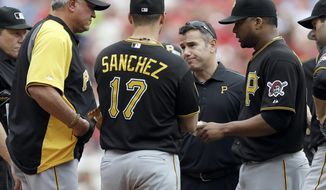 Pittsburgh Pirates starting pitcher Francisco Liriano, right, hands the ball to manager Clint Hurdle, left, as he leaves the baseball game during the third inning against the St. Louis Cardinals on Saturday, April 26, 2014, in St. Louis. (AP Photo/Jeff Roberson)