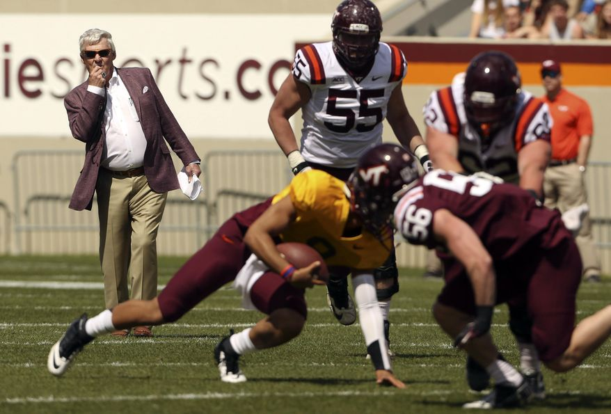 Virginia Tech head coach Frank Beamer, left, watches quarterback Brenden Motley carries the ball during during their spring NCAA college football game in Blacksburg, Va., Saturday April 26 2014. (AP Photo/The Roanoke Times, Matt Gentry) LOCAL TV OUT; SALEM TIMES REGISTER OUT; FINCASTLE HERALD OUT;  CHRISTIANBURG NEWS MESSENGER OUT; RADFORD NEWS JOURNAL OUT; ROANOKE STAR SENTINEL OUT
