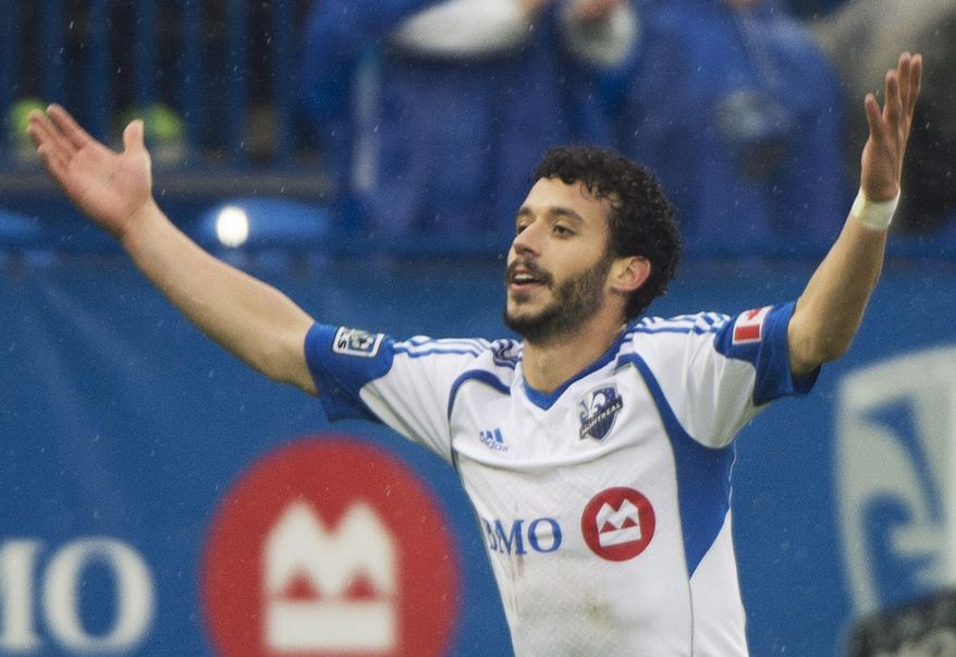 Montreal Impact's Felipe Martins celebrates after scoring against the Philadelphia Union during the first half of an MLS soccer game in Montreal, Saturday, April 26, 2014. (AP Photo/The Canadian Press, Graham Hughes) ** FILE **