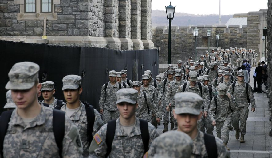 In this April 9, 2014, photo, columns of West Point cadets march to lunch at the United States Military Academy in West Point, N.Y. (AP Photo/Mel Evans)