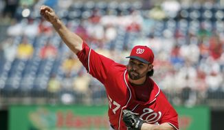 Washington Nationals pitcher Tanner Roark throws during the first inning of a baseball game against the San Diego Padres at Nationals Park Saturday, April 26, 2014, in Washington. (AP Photo/Alex Brandon)