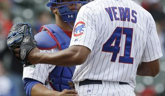 CORRECTS NAME OF WINNING TEAM - Chicago Cubs catcher Welington Castillo, left, talks with relief pitcher Jose Veras (41) during the eighth inning of a baseball game against the Arizona Diamondbacks in Chicago, Thursday, April 24, 2014. The Diamondbacks won 5-2. (AP Photo/Nam Y. Huh)