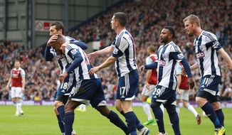 West Bromwich Albion's Saido Berahino, second left, celebrates scoring against West Ham United with his teammates during their English Premier League soccer match at The Hawthorns, West Bromwich, England, Saturday, April 26, 2014. (AP Photo/Barrington Coombs, PA Wire)   UNITED KINGDOM OUT   -   NO SALES   -   NO ARCHIVES