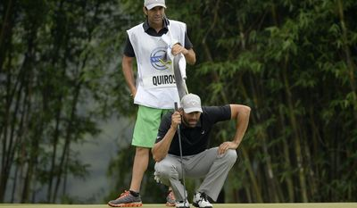 In this photo released by OneAsia, Alvaro Quiros of Spain lines up putt during the third round of the Volvo China Open at Genzon Golf Club in Shenzhen, southern China, Saturday, April 26, 2014. (AP Photo/OneAsia, Paul Lakatos) NO LICENSING