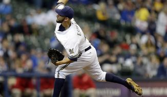 Milwaukee Brewers starting pitcher Marco Estrada throws to the Chicago Cubs during the first inning of a baseball game on Saturday, April 26, 2014, in Milwaukee. (AP Photo/Jeffrey Phelps)