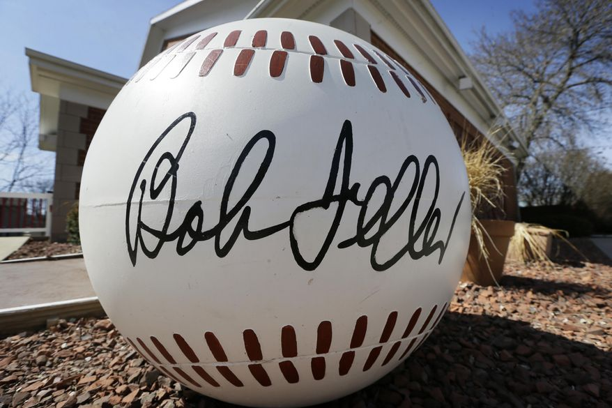 ADVANCE FOR WEEKEND, APRIL 25-27 - A large baseball sits outside the entrance to the Bob Feller Museum, Friday, April 11, 2014, in Van Meter, Iowa. In this tiny town west of Des Moines, things have slowed down considerably at the museum, a shrine to the Cleveland Indians star who died three years ago. Visitors are rare, the schedule is shorter and there is growing concern that the museum will be shuttered. (AP Photo/Charlie Neibergall)