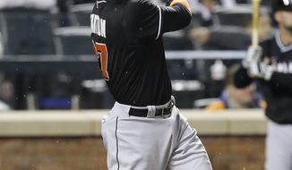 Miami Marlins' Giancarlo Stanton follows through on a two-run home run during the sixth inning of a baseball game against the New York Mets, Saturday, April 26, 2014, in New York. (AP Photo/Frank Franklin II)