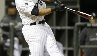 Chicago White Sox's Jose Abreu hits a grand slam against theTampa Bay Rays during the ninth inning of a baseball game in Chicago on Friday, April 25, 2014. The White Sox won 9-6. (AP Photo/Nam Y. Huh)