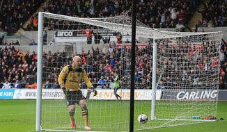 Aston Villa's goalkeeper Bradley Guzan reacts after Swansea City's Jonjo Shelvey, not in picture, scores his team's second goal during their English Premier League soccer match at the Liberty Stadium, Swansea, Wales, Saturday, April 26, 2014. (AP Photo/Nick Potts, PA Wire)    UNITED KINGDOM OUT   -   NO SALES    -    NO ARCHIVES