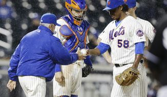 New York Mets manager Terry Collins, left, takes starting pitcher Jenrry Mejia (58) out of the game during the sixth inning of a baseball game against the Miami Marlins, Saturday, April 26, 2014, in New York. (AP Photo/Frank Franklin II)