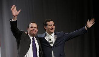 Sen. Mike Lee, R-Utah, left, and Sen. Ted Cruz, R-Texas, greet the audience during a rally at the Western Republican Leadership Conference Friday, April 25, 2014, in Sandy, Utah. Cruz, headlined the final day of a two-day conference in Utah where Republican party leaders from western states are meeting. (AP Photo/Rick Bowmer)