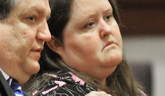 In this April 15, 2014 photo, Rachael Michelle Rapraeger, right, sits with her attorney, Floyd Buford, during a sentencing hearing.  Rachael Rapraeger pleaded guilty this month to 10 misdemeanor charges of reckless conduct and one felony charge of computer forgery after she admitted falsifying hundreds of mammogram reports. (AP Photo/The Macon Telegraph, Beau Cabell)