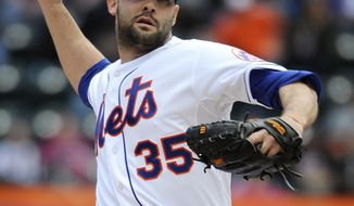 New York Mets starting pitcher Dillon Gee (35) throws against the Miami Marlins in the first inning of a baseball game at Citi Field on Sunday, April 27, 2014, in New York. (AP Photo/Kathy Kmonicek)