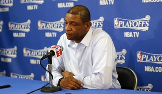 Los Angeles Clippers head coach Doc Rivers, right, answers questions during a pregame news conference before Game 4 of an opening-round NBA basketball playoff series against the Golden State Warriors on Sunday, April 27, 2014, in Oakland, Calif. (AP Photo/Marcio Jose Sanchez)