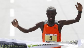Bernard Kipkorir Talam of Kenya crosses the finish line to win the 27th international Belgrade Marathon race, in Belgrade, Serbia, Sunday, April 27, 2014. Talam finished in 2 hours, 14 minutes and 35 seconds. (AP Photo/Darko Vojinovic)