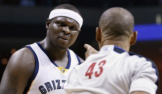 Referee Dan Crawford (43) calls a foul on Memphis Grizzlies forward Zach Randolph in the first half of Game 4 of an opening-round NBA basketball playoff series between the Grizzlies and the Oklahoma City Thunder on Saturday, April 26, 2014, in Memphis, Tenn. (AP Photo/Mark Humphrey)