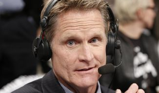 TNT commentator and former Chicago Bulls and San Antonio Spurs guard Steve Kerr broadcasts courtside for Game 4 of an NBA basketball first-round playoff series between the Toronto Raptors and the Brooklyn Nets, Sunday, April 27, 2014, in New York. Kerr said Sunday he spoke with New York Knicks President Phil Jackson twice over the weekend and that they will continue discussing his potential of becoming coach of the team. (AP Photo/Kathy Willens)