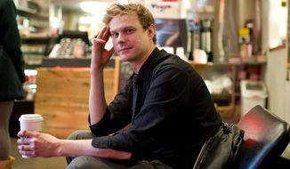 Relief: Nicholas Rastenis takes a brief break from work at a coffee shop in 2012. Since then, he has been handed a big break: a full-time job in his chosen field. (Brian Kersey/Special to the Washington Times)