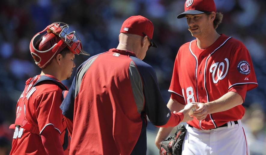Washington Nationals relief pitcher Ross Detwiler, right, is pulled from the game by manager Matt Williams, left, during the sixth inning of a baseball game against the San Diego Padres, Sunday, April 27, 2014, in Washington. The Padres won 4-2. (AP Photo/Nick Wass)