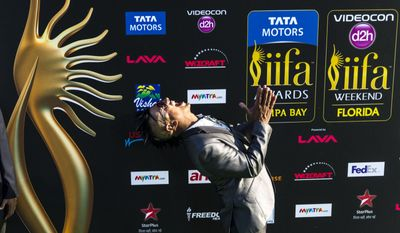 DJ Ravi Drums poses for pictures on the Green Carpet of the 15th International Indian Film Academy Awards at Raymond James Stadium on Saturday, April 26, 2014 in Tampa, Fla. (AP Photo/Tampa Bay Times, Kent Nishimura)