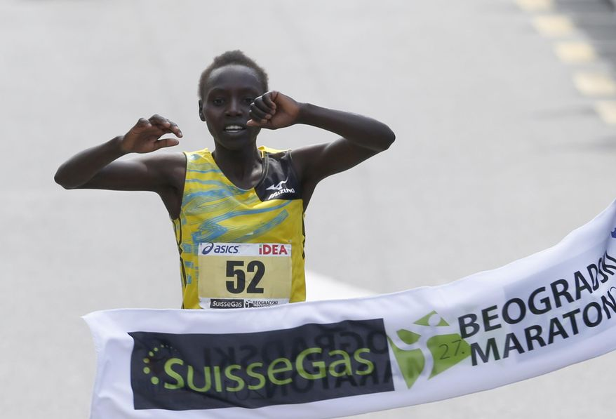 Valary Jemeli Aiyabei of Kenya crosses the finish line to win the women's event at the 27th international Belgrade Marathon race, in Belgrade, Serbia, Sunday, April 27, 2014. Aiyabei finished in 2 hours, 37 minutes and 8 seconds. (AP Photo/Darko Vojinovic)
