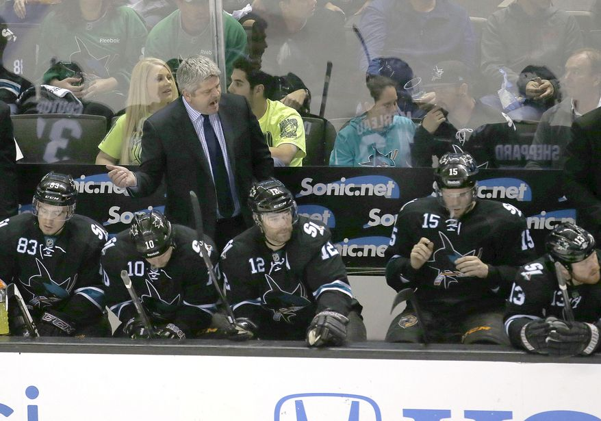 San Jose Sharks head coach Todd McLellan yells to his players during the third period against Los Angeles Kings in Game 4 of an NHL hockey first-round playoff series in San Jose, Calif., Saturday, April 26, 2014. Los Angeles won 3-0.  (AP Photo/Tony Avelar)