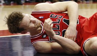 Chicago Bulls forward Mike Dunleavy lies on the court after an injury during the second half of Game 4 of an opening-round NBA basketball playoff series against the Washington Wizards in Washington, Sunday, April 27, 2014. The Wizards defeated the Bulls 98-89. (AP Photo/Alex Brandon)