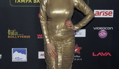 Indian film star Kainaat Arora poses for photographers as she walks the green carpet for the 15th annual International Indian Film Awards Saturday, April 26, 2014, in Tampa, Fla. (AP Photo/Chris O'Meara)