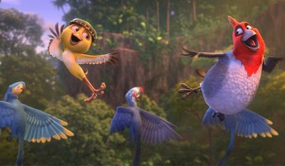 """This image released by 20th Century Fox shows Nico, voiced by Jamie Foxx, foreground left, and Pedro, voiced by will.i.am in a scene from the animated film """"Rio 2."""" (AP Photo/20th Century Fox- Blue Sky Studios)"""
