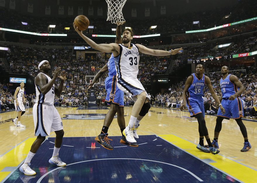 Memphis Grizzlies center Marc Gasol (33) scores against Oklahoma City Thunder center Kendrick Perkins (5) in the second half of Game 4 of an opening-round NBA basketball playoff series Saturday, April 26, 2014, in Memphis, Tenn. Oklahoma City won in overtime 92-89. (AP Photo/Mark Humphrey)