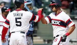 After hitting a two-run home run, Chicago White Sox designated hitter Jose Abreu celebrates with teammate Marcus Semien, who scored, during the sixth inning of a baseball game against the Tampa Bay Rays on Sunday, April 27, 2014, in Chicago. (AP Photo/Andrew A. Nelles)