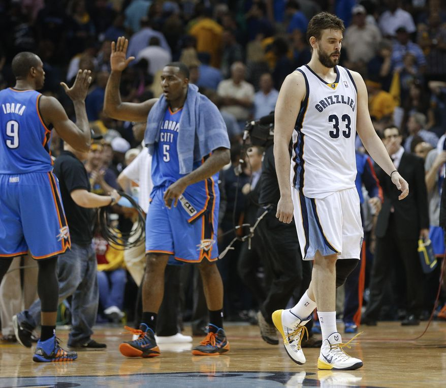 Memphis Grizzlies center Marc Gasol (33) leaves the court as Oklahoma City Thunder players Serge Ibaka (9) and Kendrick Perkins (5) celebrate after overtime in Game 4 of an opening-round NBA basketball playoff series Saturday, April 26, 2014, in Memphis, Tenn. Oklahoma City won 92-89. (AP Photo/Mark Humphrey)